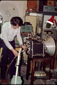 Jan King, K8GEY, gives the partially assembled AMSAT-OSCAR-8 a thorough cleaning n the basement of his home.