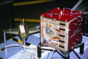 The ITAMSAT Packet Radio satellite that later became ITALY OSCAR 26 on orbit. Note the highly advanced ejection system (consisting of a simple hardware-store spring!) on the mounting platform.