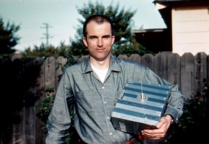 Lance Ginner, K6GSJ, poses with the flight model of Amateur Radio's first satellite....OSCAR-1.