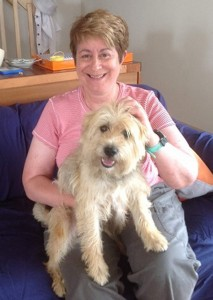 """AMSAT's full time office manager, Martha Saragovitz, and her newest """"assistant"""" named Spencer."""
