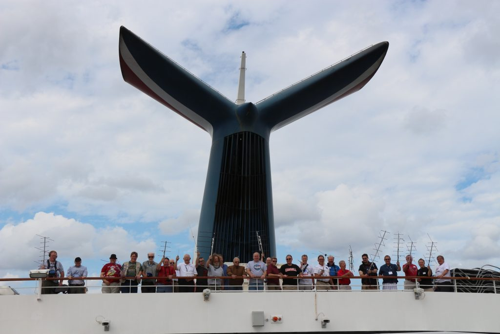 AMSAT members display their portable antennas from the aft deck of the Carnival Liberty during the 2016 AMSAT Space Symposium